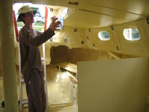 Pete installing ceiling panels