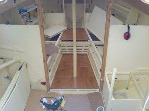 Varnished floor panels at front of boat