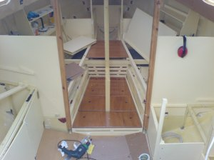 Varnished floor panels at front of boat