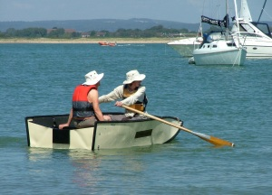 Pete rowing his mum out to the boat
