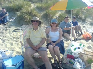 Mum, Dad and the only shade on the beach